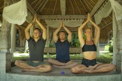 Free Happy Group Of Young Hipster American Friends Enjoying Asian Yoga Retreat Together Sitting On Lotus Position Meditating At Royalty Free Stock Images - 163522339