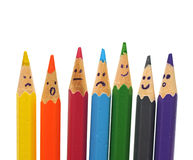 Happy group of pencil faces as social network. Isolated on white Royalty Free Stock Photo