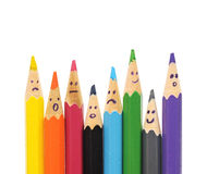 Happy group of pencil faces as social network. Isolated on white Royalty Free Stock Photography