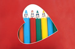 Happy group of pencil faces Stock Photos