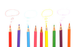 Happy group of pencil faces with speech bubble Royalty Free Stock Images