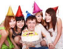 Happy group of people with cake. Royalty Free Stock Image