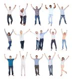 Happy group of people dressed in casual. Raising Arm Over White Background Stock Photography