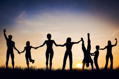 Happy group of people, friends, family together, having fun. Happy group of people, friends, family standing together hands in hands, having fun, celebrating Royalty Free Stock Photography