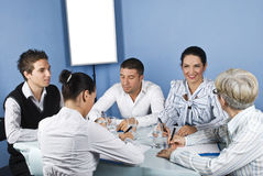 Happy group of people having conversation. Happy group of people have an conversation at  business meeting in office,check also Business people ,laptop and money Royalty Free Stock Images