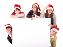 Happy group  people  in santa hat whith banner. Royalty Free Stock Photo