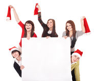 Happy group  people  in santa hat whith banner. Stock Photography