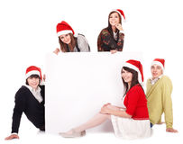 Happy group  people  in santa hat whith banner. Royalty Free Stock Image