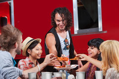 People Sharing Pizza Royalty Free Stock Photos