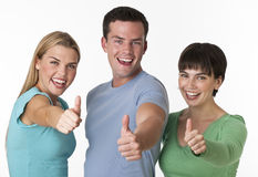 Happy Group Posing With Thumbs Up Royalty Free Stock Photography