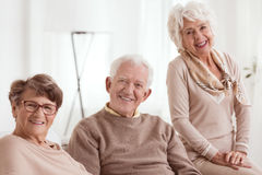 Happy group of seniors. Smiling, light background Stock Photo