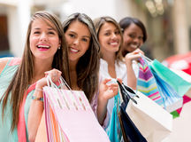 Happy group of shopping friends Stock Image