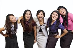 Happy Group Smiling. Happy group of attractive young women smiling isolated on white background Royalty Free Stock Images