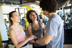 Group of sportive people in a gym. Concepts about lifestyle and sport in a fitness club royalty free stock photos