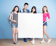 Happy group student. Take billboard on the blue background stock photos