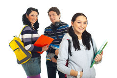 Happy group of students. Smiling student girl holding notebook and her colleagues isolated on white background Stock Photography