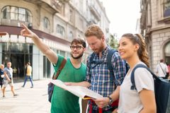 Happy group of students on adventure. Happy group of students on sightseeing and travel adventure Stock Image