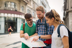 Happy group of students on adventure. Happy group of students on sightseeing and travel adventure Royalty Free Stock Image