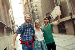 Happy group of students on adventure. Happy group of students on sightseeing and travel adventure Royalty Free Stock Photos