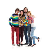 Happy group of students. Four smiling young students standing together. Full length studio shot  on white Stock Photography