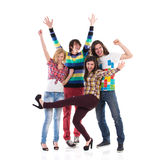 Happy group of students. Four young students shouting with arms raised. Full length studio shot isolated on white Royalty Free Stock Photography