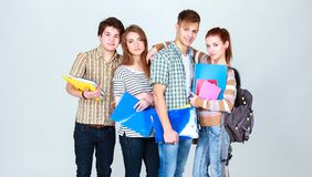 Happy group of students holding notebooks , isolated on white background stock images