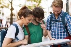 Happy group of students on adventure. Happy group of students on sightseeing and travel adventure Stock Photo