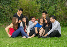 Happy group of students sitting at the park Royalty Free Stock Image