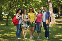 Happy group of students. Smiling outdoors Royalty Free Stock Photography