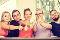 Happy group of students with thumbs up. Education, friendship, success and teenage concept. Team of friends college students giving thumb up gesture of approval Stock Photos