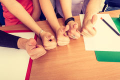 Happy group of students with thumbs up Royalty Free Stock Image