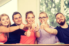 Happy group of students with thumbs up Royalty Free Stock Photography
