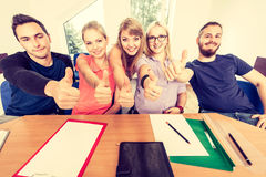 Happy group of students with thumbs up Stock Photo