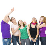 Happy group of teenagers. Group of teenagers looking up and pointing towards something Stock Photo