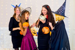 Happy group of teenagers dance in Halloween costumes Stock Photography