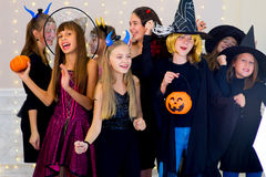 Happy group of teenagers dance in Halloween costumes Royalty Free Stock Photos