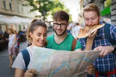 Happy group of tourists traveling and sightseeing. Together Royalty Free Stock Images