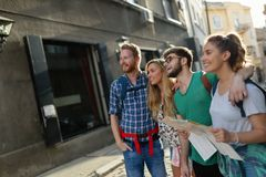 Happy group of tourists traveling and sightseeing. Together Stock Photography