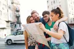 Happy group of tourists traveling and sightseeing. Together Stock Photo