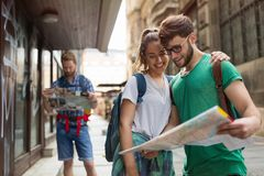 Happy group of tourists traveling and sightseeing. Together Royalty Free Stock Photography