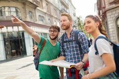 Happy group of tourists traveling and sightseeing. Together Royalty Free Stock Image