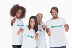Happy group of volunteers giving thumbs up Stock Image