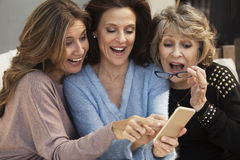 Happy group of women having fun with mobile phone Royalty Free Stock Photography