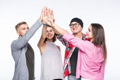Happy group of young friends giving high-five isolated over a white background. Happy group of young friends giving a high-five isolated over a white background Stock Images