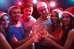 Happy group of young friends. Touching the glases with each other royalty free stock photos