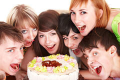 Happy group of young people with cake. Royalty Free Stock Photography