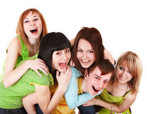 Happy group of young people in green. Isolated Stock Image