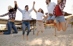 Happy group of young people having fun at beach Royalty Free Stock Photos