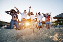 Happy group of young people having fun at beach Royalty Free Stock Images
