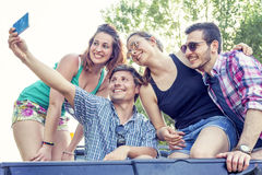 Happy group of young people takes a selfie Stock Photos